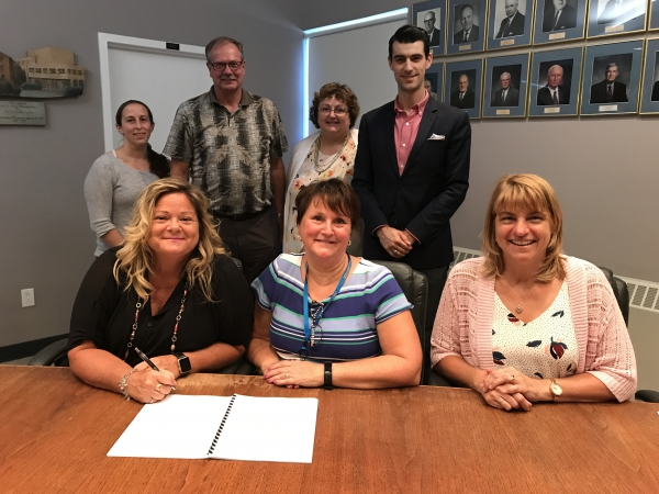 Two groups sign first contracts