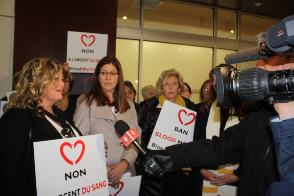 NBU President Susie Proulx-Daigle answers questions from the media regarding the petition delivered to Health Minister Victor Boudreau opposing the pay-for-donation blood plasma clinic set to open in Moncton.