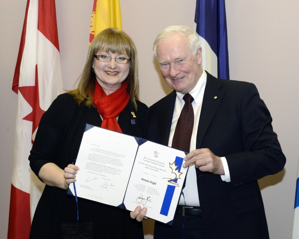 Brenda Daigle poses with the Governor General of Canada, David Johnston. Daigle was the recipient of the Governor General's Caring Canadian Award.